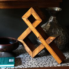 """No you haven't accidentally clicked on a link to Crate and Barrel, this is a 100% Workerman design!      Standing around 16"""" tall this rugged looking hand made ampersand, is made from a single FSC certified 2""""X4"""" stud.  All markings/stampings are left on the wood as well.  Stands on a tabletop or..."""