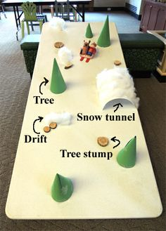 Hit the slopes with a box sled, tp tube riders, and a fantastic winter obstacle course (created on a plastic table top)