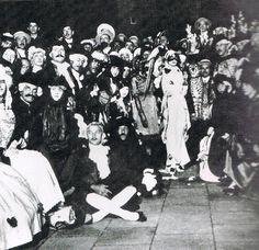 Marchesa Luisa Casati besides one of her leopards, wearing Leon Bakst's Arlecchino Bianco costume at hermasquerade, c. 1913.