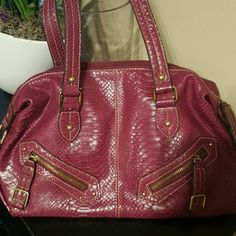 Detailed with gold zippers snakeskin type purse Purple bag used once perfect condition Bags Totes