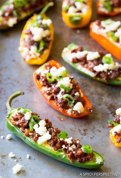 Loaded Stuffed Jalapeños piled with smoked cheddar, chorizo, queso fresco, and green onions. A fabulous party snack to serve with margaritas and guacamole!