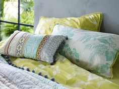 This rectangular cushion features elegant embroidery and stitched detailing in an array of pastel hues.