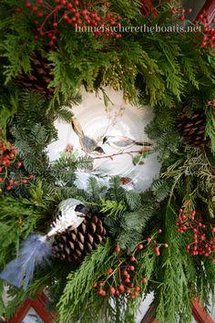 christmas wreath framing a plate with clip on bird ornament homeiswheretheboa wreath - Christmas Greens