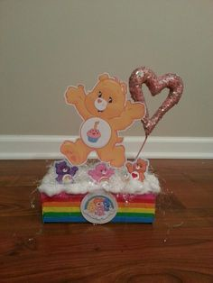carebear centerpiece, rainbow Care Bear Birthday, Care Bear Party, Baby Shower Pin, 2nd Baby Showers, 1st Birthday Parties, 3rd Birthday, Girl Scout Bridging, Bear Decor, Baby Shower Centerpieces