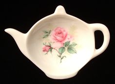 This is a bone china teapot shaped tea bag holder with a lovely floral design of pink roses and foliage made in 2003 by Allyn Nelson, who merged into Royal Patrician, England which unfortunately close
