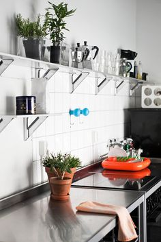 White and steel interior shot of a kitchen