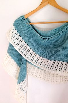 Free Knitting Pattern for Hill Island Wrap with 4 row repeat edging - Crescent shaped shawl worked from the top down in garter stitch. The 4 row repeat lace edging is knit on continuously and may or may not be worked in a contrasting color. DK weight yarn. Designed by Little Church Knits