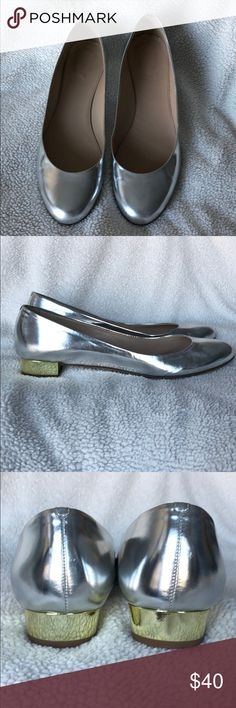 J Crew flats Adorable silver leather flats with a little gold heel. Worn a couple of times. In excellent condition. One smudge on left toe (last pic). Heel is less than 1 inch. J. Crew Shoes