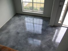 Acid Stained Overlay. I am thinking of doing something similar in my house and then utilize throw rugs for color and sound dampening.