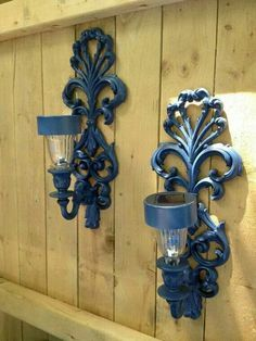 Use candle sconces and solar lights on a fence for outdoor lighting