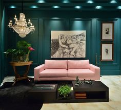 These deep dark green walls look moody against the trend for pale pink sofa in this stunning interior