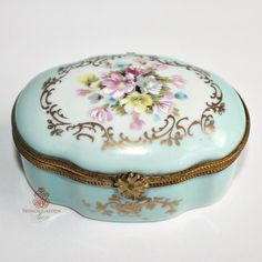 Fine quality French Limoges Floral Miniature Box beautifully hand painted with roses and other garden favorites, and accented with gilt details. The color of this box is rarer to find, it's that romantic and delicate shabby Blue we all adore. The painting was done by one of the best artists, the ormolu mount closure works well, the little flower is beyond charming. Colors are blue, pink, white, lavender, purple, yellow, gold, green, and grey. Decorative, and so beloved, this small porce...
