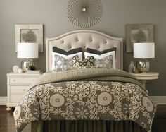 Throw pillows are an easy and inexpensive way to add visual weight to a bedroom. Image Via: Bassett