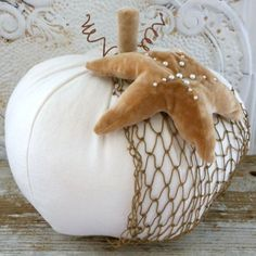 Cute fabric pumpkin with starfish and fishnet.