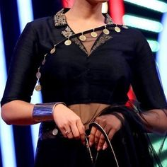 blouse designs Looking for designer blouse patterns for sarees? Here are 15 most flattering models that will go well with any saree. Do try them and look chic. Blouse Back Neck Designs, Silk Saree Blouse Designs, Fancy Blouse Designs, Saree Blouse Patterns, Bridal Blouse Designs, Latest Blouse Patterns, Indian Blouse Designs, Latest Blouse Designs, Golden Blouse Designs