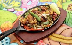 The Camarones a la Plancha (grilled shrimp) are served in a skillet at Mariscos Playa Hermosa in Phoenix.