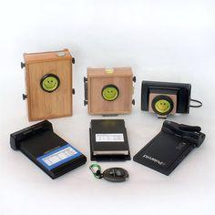 Pinhole cameras modified for instant film.  Genius!