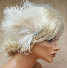 Check out this item in my Etsy shop https://www.etsy.com/listing/454916140/wedding-fascinator-feather-hair-clip