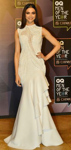 Deepika Padukone at a gala event looking stunning in a white gown with straightened hair and smoky black makeup... she looks good no matter what she wears