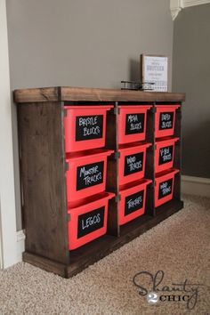 Need to make. Maybe a smaller version. .... Cheap IKEA tubs + a few boards = toy storage solution.