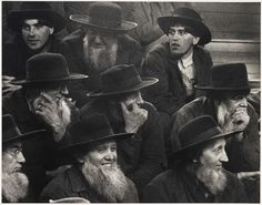 AMISH FARMERS AT A HORSE AUCTION, 1955 by Todd Webb