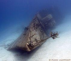 FRIGATE 356, a 306 foot long Soviet built Cuban warship from the late Cold War era, lies in ghostly stillness 40-90 feet beneath the surface in Cayman Brac.