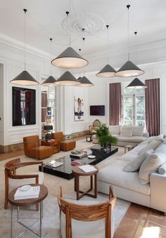 Lighting!   Nice mix of contemporary in a very traditional room.