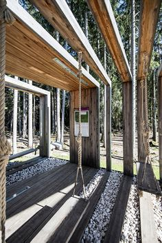 noa builds swinging frames installation from wooden posts
