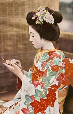 Maiko Teru checking her Make-up 1930s. Before WWII Maiko were children, indentured servants to geisha houses, trained to please men. Sold by poor families when only five or six years old.