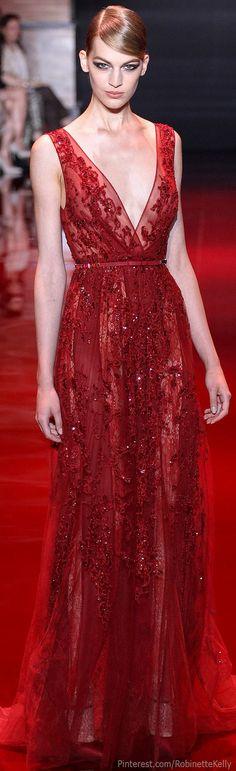 Elie Saab . Deep V neck and belt detail #reddress