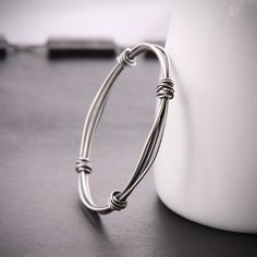 Modern silver bangle with a sleek and edgy charcoal finish handcrafted with different gauges of sterling wire - Bundle Hoop Bracelet. $65.00, via Etsy.