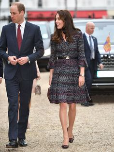 Stunning: Kate was wearing a chic Chanel suit - a choice bound to delight fashionistas - as she entered the hospital this morning