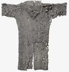 10th-13th Century military costume: chain-mail was worn as protection under the surcote. It was wade of interlocked metal rings, plates of metal, hardened leather, whalebone, or horn.