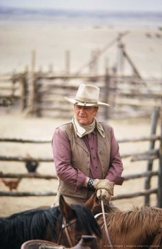 John Wayne..........you're cowBOYS not cowMEN not by a damn sight