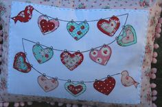 String of Hearts Pillow by Lovely Little Handmades