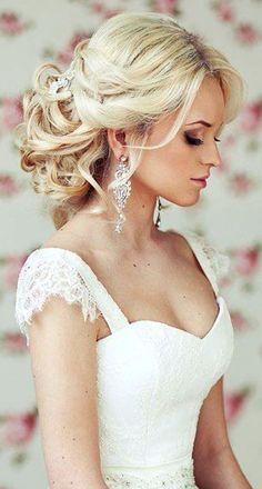 Bride's loose chignon messy bun bridal hair