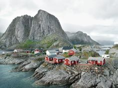 rocks and oceans and red houses