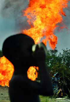 Shell gas flare in the Niger Delta by George Osodi, 2006