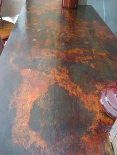 Decorative counter top resurfaced over old laminate using Modern Masters Metal Effects | By KB Designs