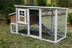 """The Silkie Chicken Coop - Dimensions: 78"""" x 30"""" x 41"""" - Perfect for 1-6 chickens - Built-in ramp give access for chicken to run into their home - Inner door slides shut with easy metal pull bar - Nest"""