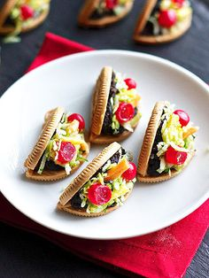 These Cinco de Mayo Treats Couldn't Be Any Cuter   OREO TACO COOKIES   Golden Oreos as taco shells, shredded coconut as lettuce and Hot Tamales as cherry tomatoes – it's official: This is the cutest dessert. Ever.