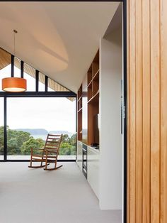 This Room11 design, dubbed the Lookout House, was made in Port Arthur, Tasmania. Named for its glass facade and interior courtyard wall, the house allows for undisturbed views of Tasman Island and the Southern Ocean. While the front of the house is predominantly glass, the sides and back are clad with vertical planks of wood, …