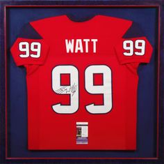 Custom framed signed JJ WATT football jersey surrounded by the Houston Texans' colors! Designed by Bradley's Art & Frame