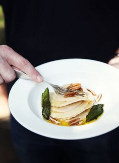 pumpkin ravioli with: brown butter sauce, toasted pecans & sage.