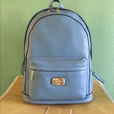 NWT Michael Kors Jet Set Blue Large Backpack Brand New With Tags, Authentic Michael Kors Jet Set Powder Blue Leather Large Backpack. Veri comfortable with Zip closure , exterior zippered pocket Gold tone Hardware and Multi functional interior pockets. Never worn Michael Kors Bags Backpacks