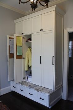 Like large cabinet, not individual so can be one large coat closet. Upper cabinet good for umbrellas and winter stuff. lockers with doors Entryway Storage Solutions Mudroom Cabinets, Mudroom Laundry Room, Tall Cabinets, Upper Cabinets, White Cabinets, Storage Cabinets, Coat Closet Organization, Entryway Organization, Organization Ideas