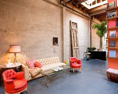Hello, gorgeous orange!  I see antique (architectural salvage) and modern (sofa/chair) here!