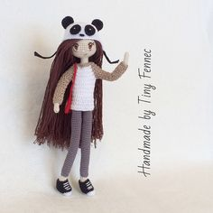 Amigurumi girl doll in a panda hat by tinyfennec. (Inspiration).
