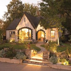 From the curb, the original Tudor cottage style evokes thoughts of Grimm's fairy tales or visiting grandmas house. And, I love the updated landscape design. It's so welcoming!