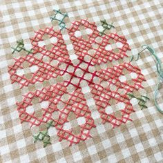 Gingham cross-stitch. Table cloth, picnic blanket, apron, and more.